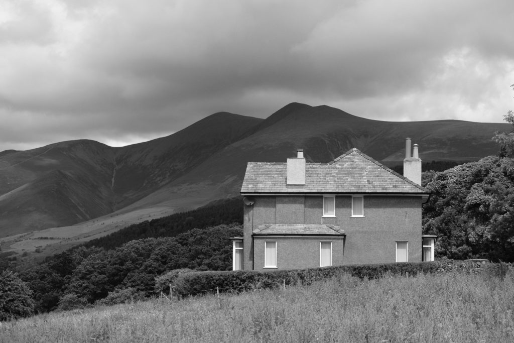 A house nearly as austere as Skiddaw behind it